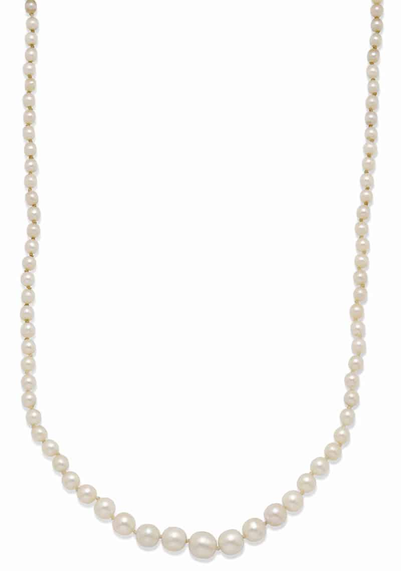 LOT 132 – A STRAND OF NATURAL PEARLS AND A SINGLE CULTURED PEARL –