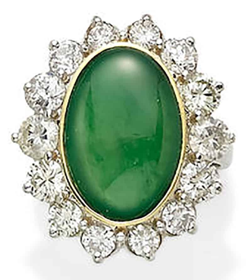 LOT 310 - A JADEITE JADE, DIAMOND, GOLD AND PLATINUM RING