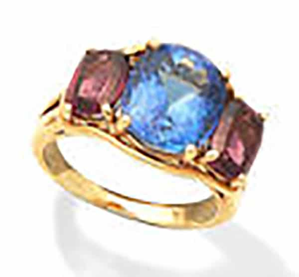 LOT 162 - A TANZANITE AND GARNET RING, by Vedura