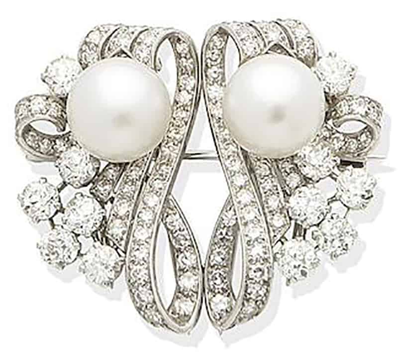 Lot 231 - A CULTURED PEARL AND DIAMOND DOUBLE-CLIP BROOCH, by Garrard, circa 1955