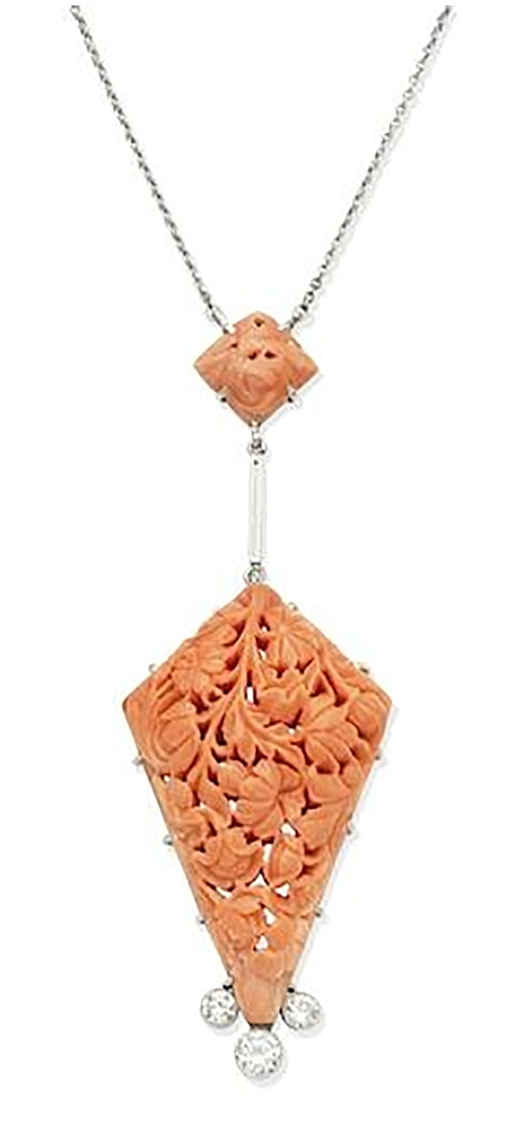 LOT 315 - A CORAL AND DIAMOND PENDANT NECKLACE