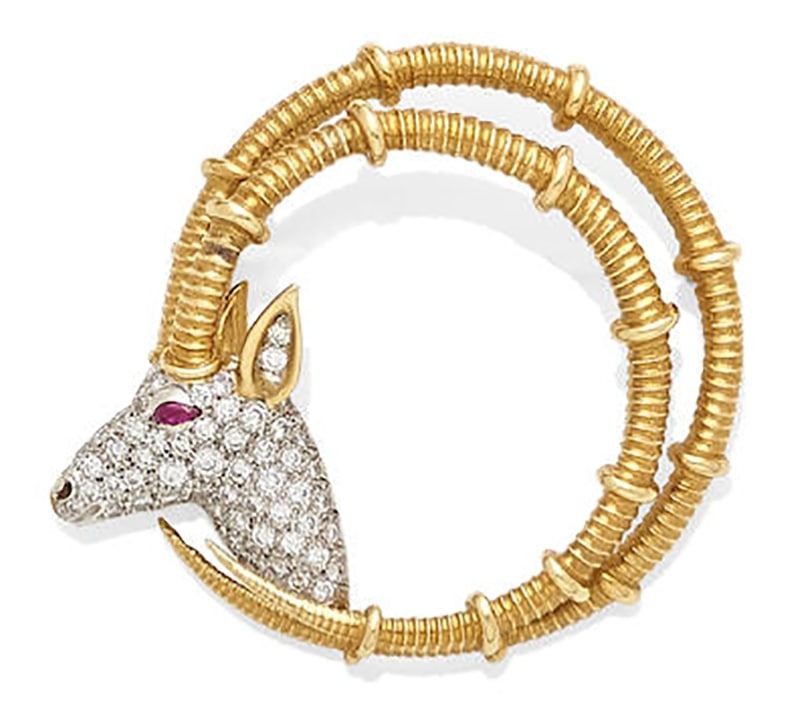 LOT 392 - A DIAMOND, RUBY AND 18K BI-COLOR GOLD 'IBEX' BROOCH, Schlumberger for Tiffany & Co.