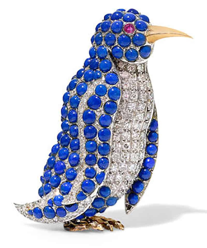 LOT 227 - A LAPIS LAZULI, DIAMOND, RUBY AND 18K BI-COLOR GOLD PENGUIN CLIP