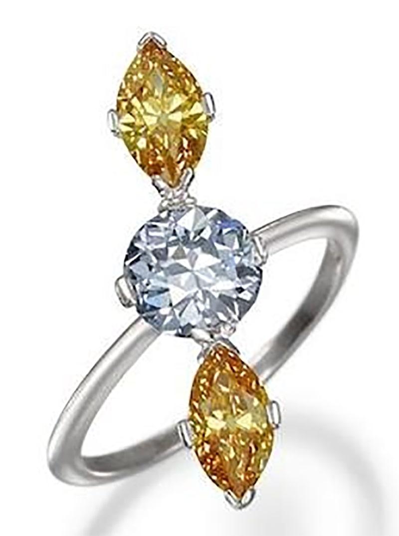 LOT 138 - A FANCY-COLORED DIAMOND THREE-STONE RING, circa 1910