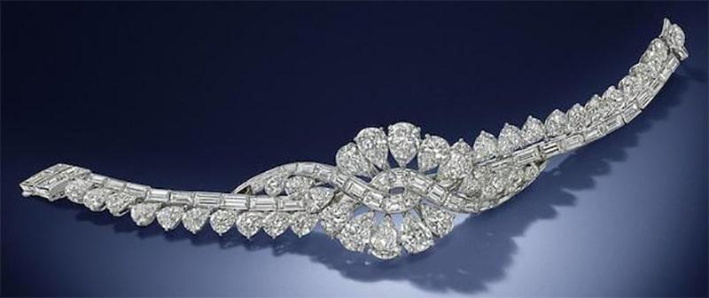 LOT 128 - A DIAMOND 'VOLUTES' BRACELET, by Van Cleef & Arpels, circa 1954