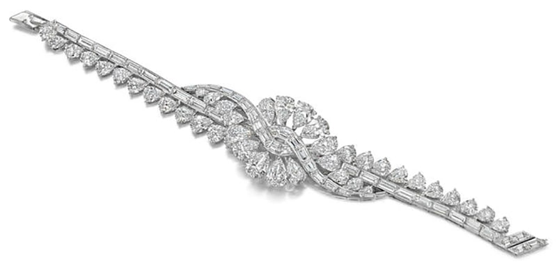 LOT 128 - ANOTHER VIEW OF THE DIAMOND 'VOLUTES' BRACELET, by Van Cleef & Arpels, circa 1954