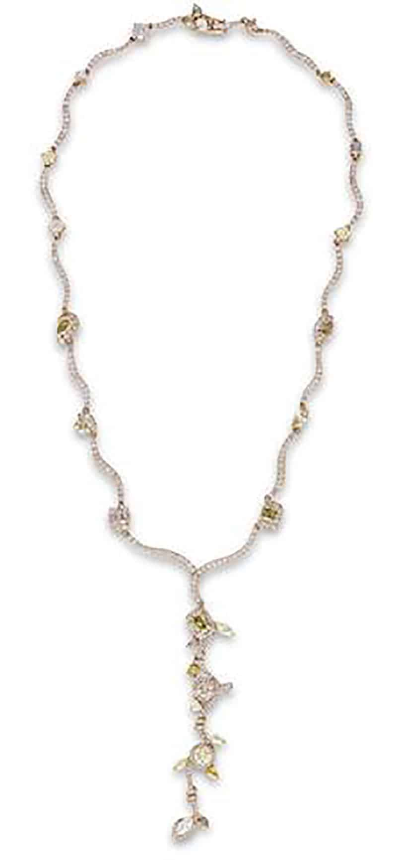 LOT 651 - A FANCY COLOURED DIAMOND AND DIAMOND NECKLACE