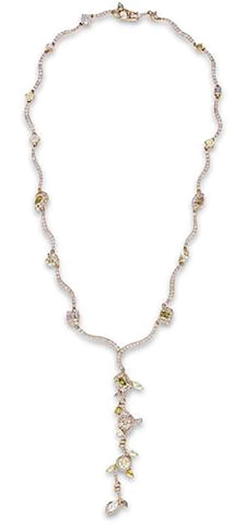 LOT 651 - A FANCY COLOURED DIAMOND AND DIAMOND NECKLACE