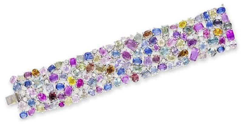 LOT 504 - A MULTI-COLOURED SAPPHIRE AND DIAMOND BRACELET