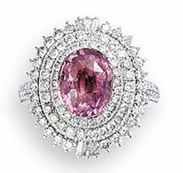 LOT 598 – A PADPARADSCHA SAPPHIRE AND DIAMOND RING