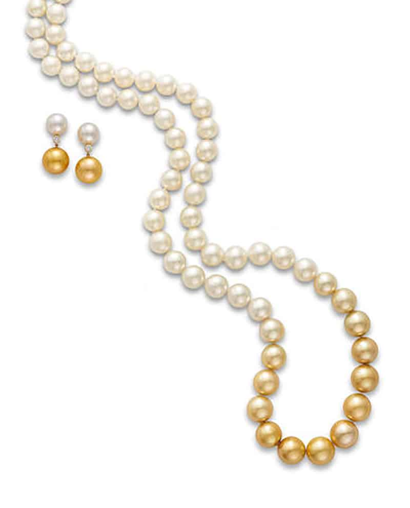 LOT 555 - A CULTURED PEARL AND DIAMOND NECKLACE AND EARRING SUITE