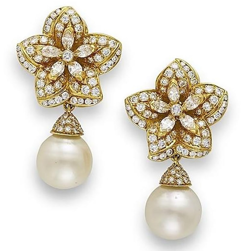 LOT 556 - A PAIR OF CULTURED PEARL AND DIAMOND EARRINGS