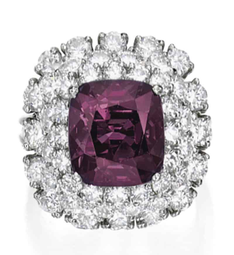 LOT 1627 - ALEXANDRITE AND DIAMOND RING IN INCANDESCENT LIGHT