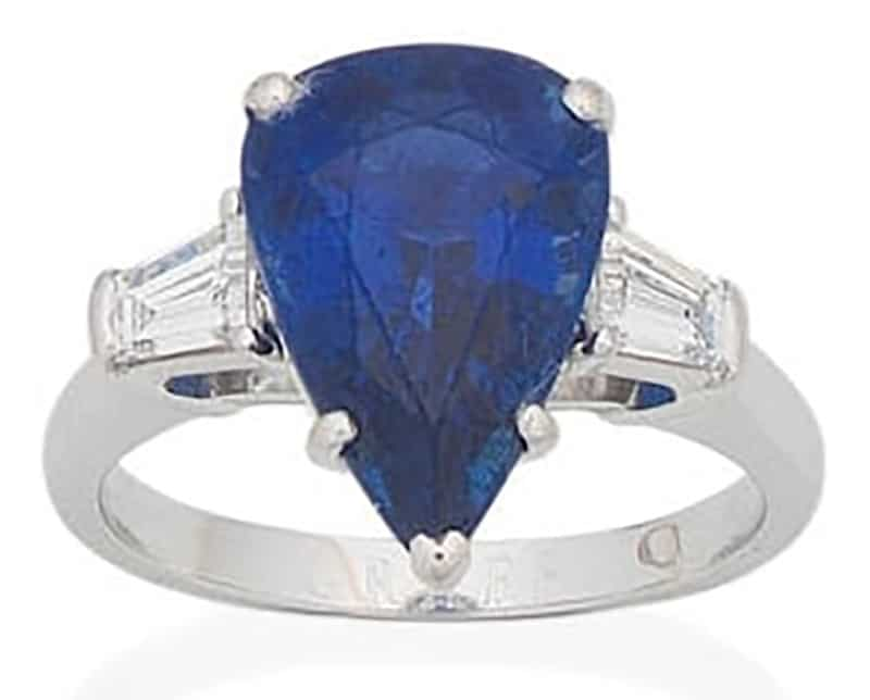 LOT 63 - A SAPPHIRE AND DIAMOND RING, by Graff