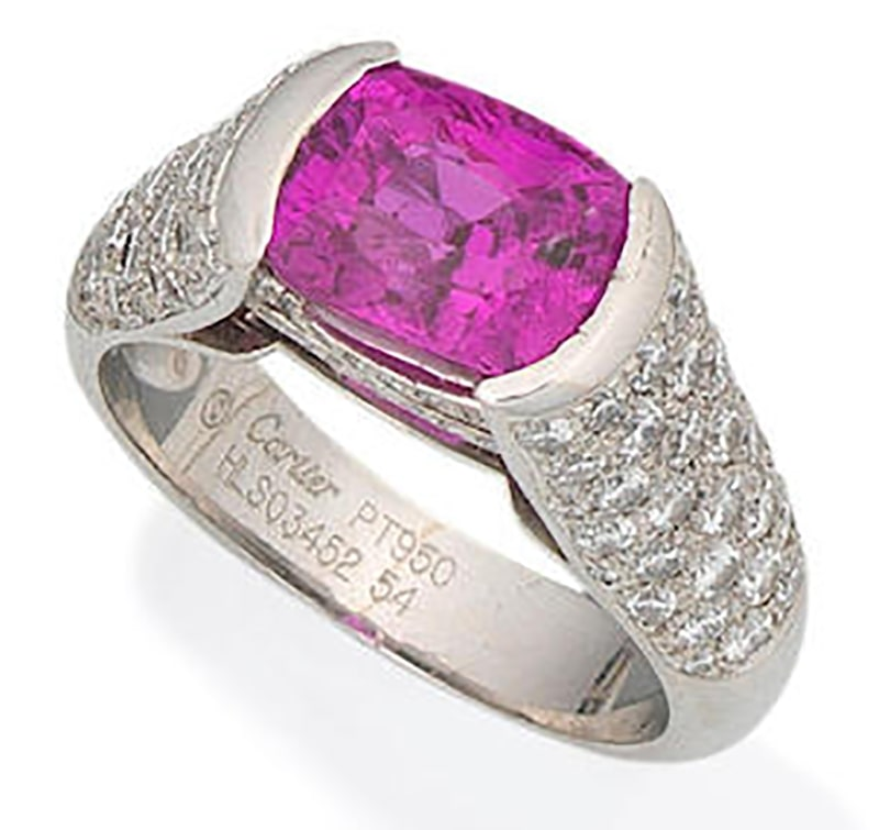 LOT 66 - A PINK SAPPHIRE AND DIAMOND RING, by Cartier