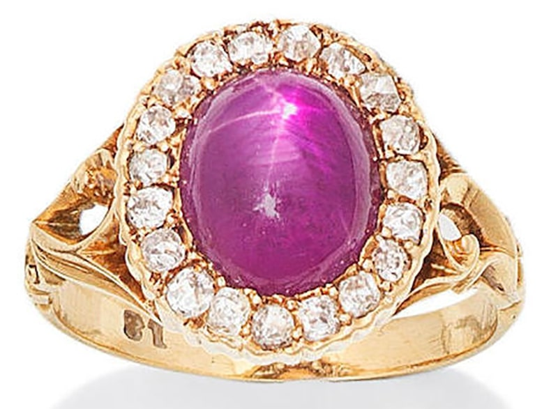 A PINK STAR SAPPHIRE AND DIAMOND CLUSTER RING