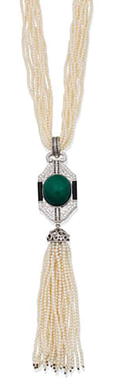 AN EMERALD, DIAMOND, BLACK DIAMOND, ONYX AND SEED PEARL SAUTOIR