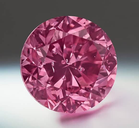 Lot 1 - Argyle Eternity - A 2.24-carat, round brilliant-cut, Fancy Vivid Purplish-Pink diamond.