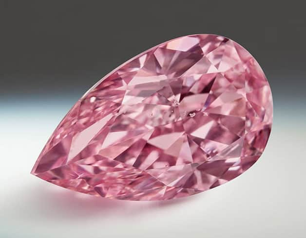 Lot 3 - Argyle Sakura - A 1.84-carat, pear-shaped, Fancy Vivid Purplish Pink diamond.