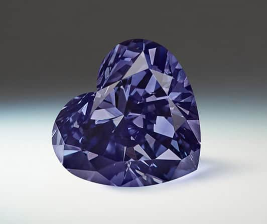 Lot 5 - Argyle Skylar - A 0.33 carat, heart-shaped, Fancy Dark Gray-Violet diamond.