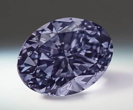Lot 6 - Argyle Infinite - A 0.70-carat, oval-shaped, Fancy Dark Violet-Gray diamond.