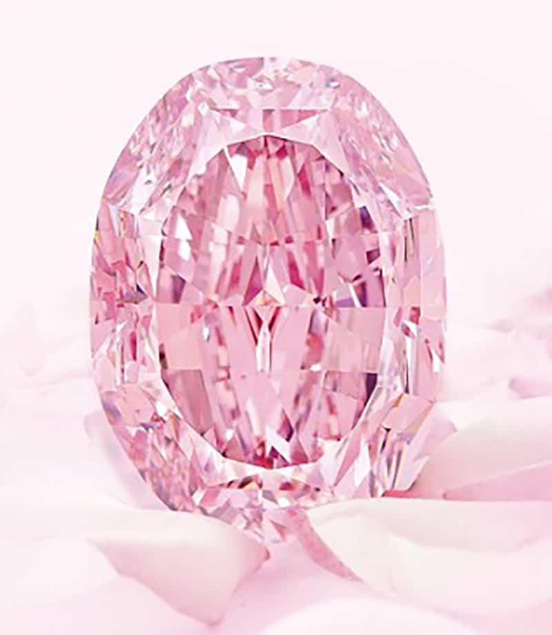 14.83-carat oval modified brilliant-cut fancy vivid purple-pink internally flawless spirit of the rose diamond.