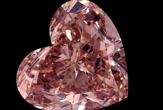 15.2 carat heart shaped fancy intense orangey pink VVS1 clarity diamond