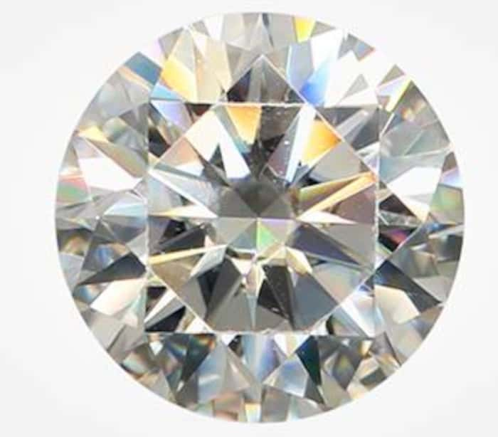 1.02 carat round brilliant cut synthetic moissanite with fradulent GIA inscription