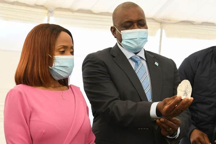 President Masisi holding the enormous diamond as first lady Jane Masisi looks on